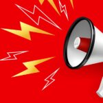 A white megaphone against a red background top represent setting up a PubMed alert