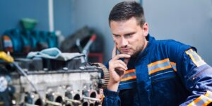 Image of a mechanic thinking before fixing a car to represent thinking before performing histology fixation