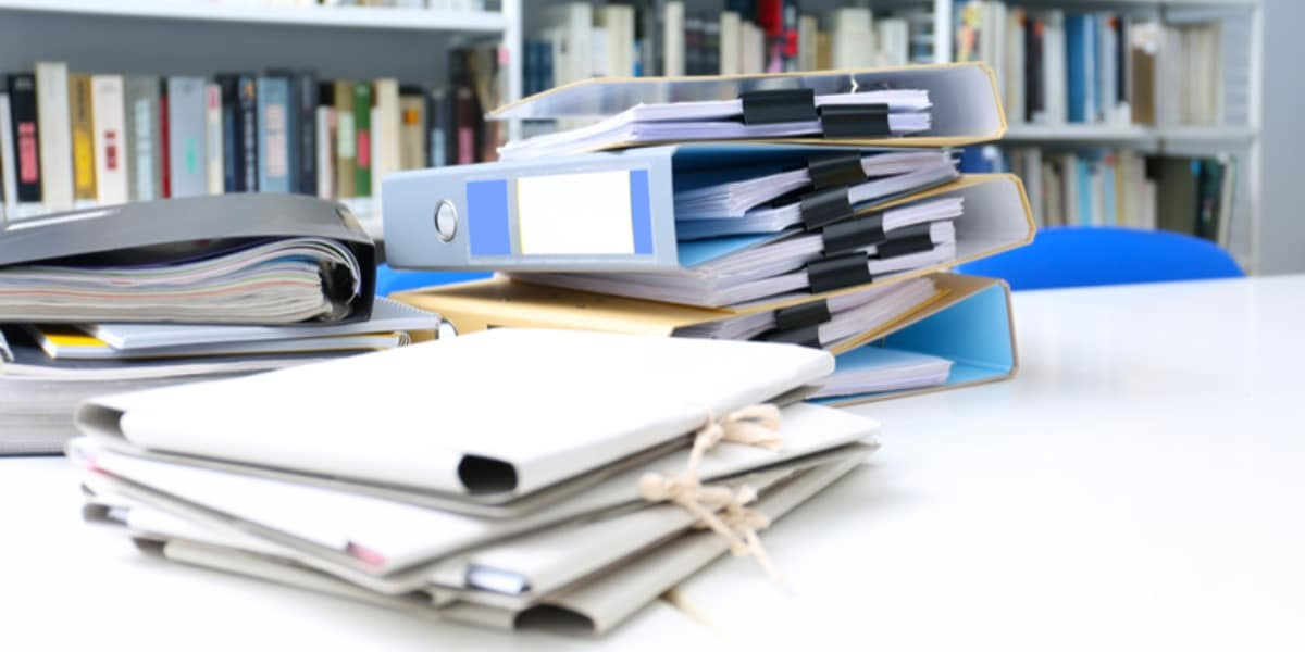 A table with stacked document wallets and folders to represent the reference manager Zotero