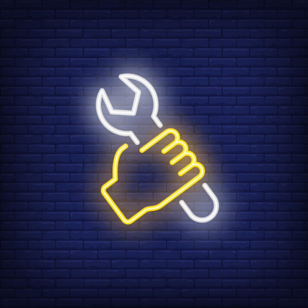 An image of a neon hand and spanner to depict MacGyver in the lab
