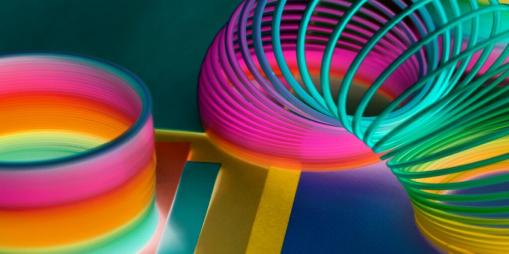 Image of a colorful spring toy depicting coils in DNA plasmid preps to help undertand why you get 3 bands when running plasmid DNA on agarose gels