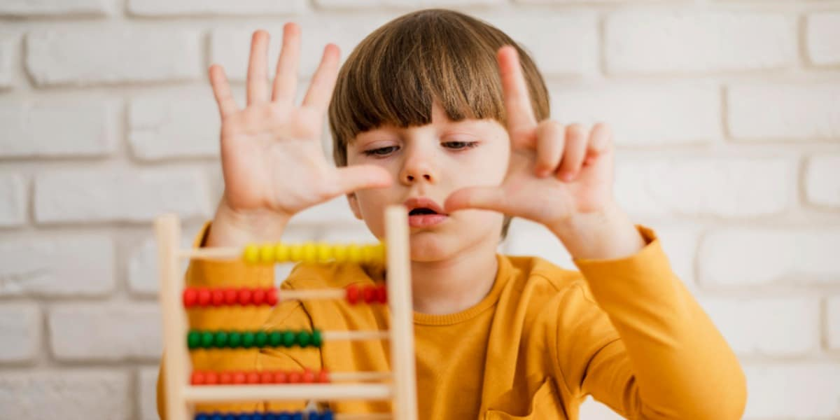 Image of a child counting using an abacus denoting the ease of counting cells using a hemocytometer