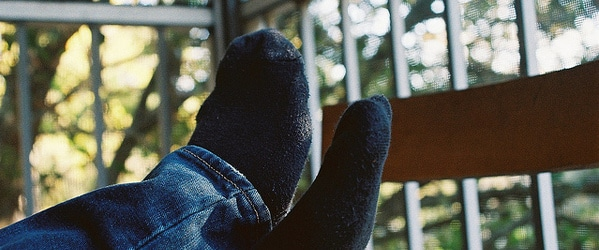 An image of a man with his feet up to depict making science life smoother.