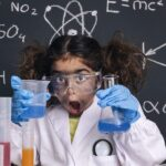 Image of a child doing science. They are amazed at finding out how SDS-PAGE Works