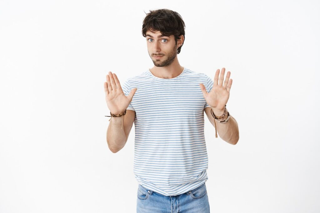 An image of a man holding his hands up to say slow down to depict caring for your centrifuge.