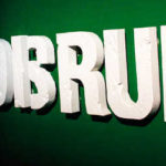 Disrupt in large letters on a wall