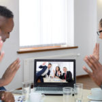 Image of a group of scientists communicating with collaborators via a video conference