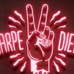 Image of a fluorescent sign saying carpe diiem to represent the issue of photodamage in fluorescent live-cell imaging