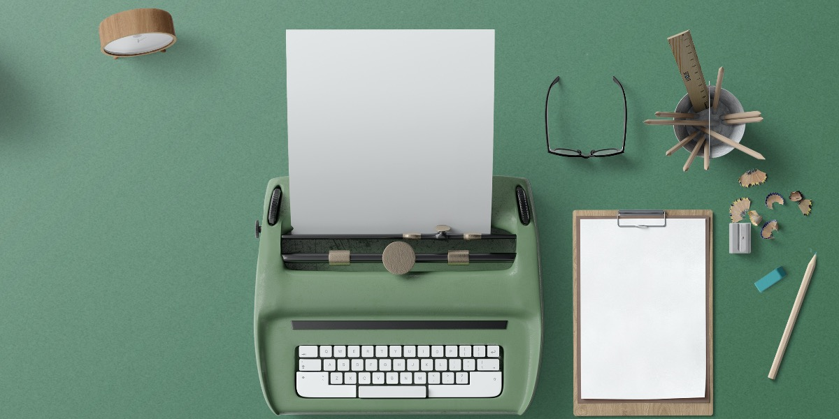 Image of typewriter and blank piece of paper to represent writing a scientific discussion