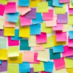 A board full of blank multicoloured sticky notes to represent planning your scientific paper