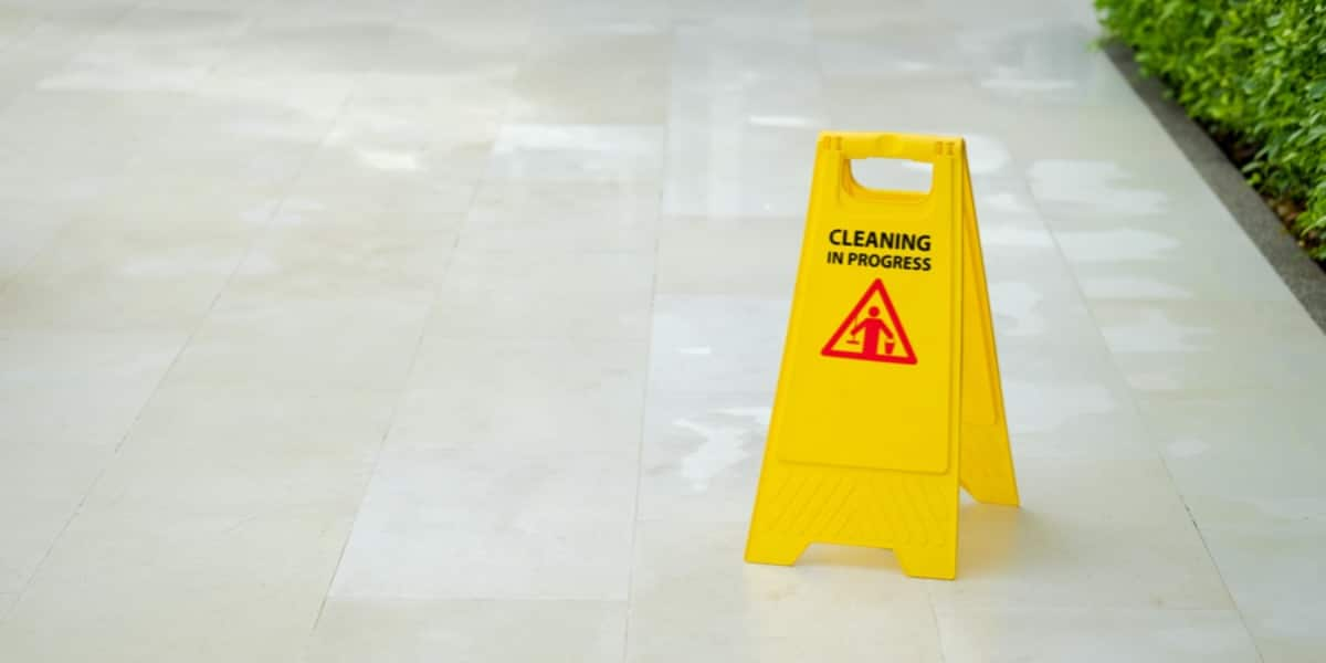 Yellow 'Cleaning in Progress' floor sign to represent effective laboratory sterilization methods