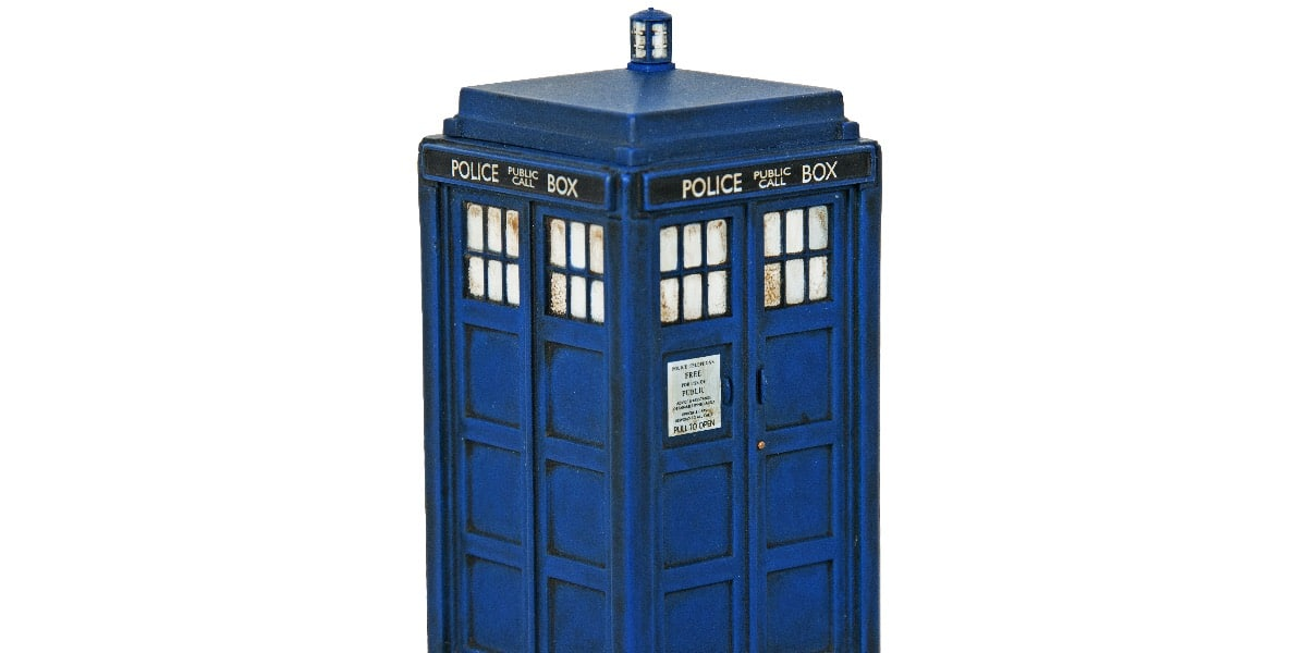 A model of Dr Who's police box Tardis on a white background to represent ways to use your Dr title for good and evil
