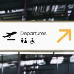 Image of an airport terminal sign signalling the way to departure gates to represent advice on how to quit graduate school