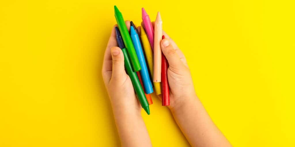 An image of a kid holding colorful pencils to depict using molecular visualization tools.