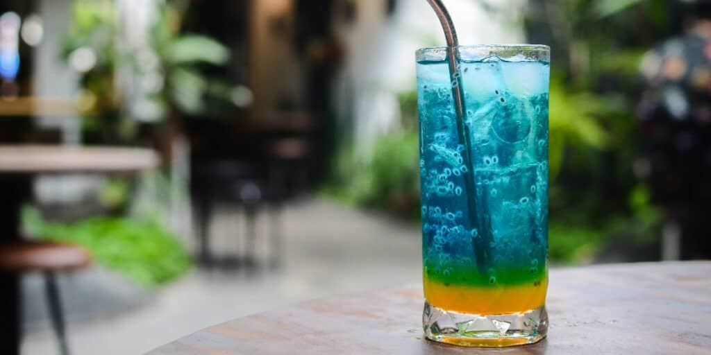 Image of blue cocktail to represent the blue dye used to when measuring protein concentration using the Bradford Assay
